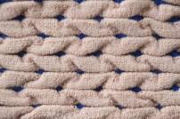 Wrinkeled pleats from shrining yarn and elastic yarn blue
