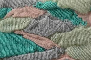 Multi-colored irregular knitted pleats